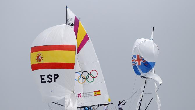 Competitors from Spain and Australia sail during the women's Elliott 6m medal race at the London 2012 Olympic Games