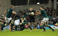 Ireland's full back Simon Zebo (2nd R) hands off South Africa's lock Eben Etzebeth (R) during their Autumn International rugby union match at the Aviva stadium in Dublin. South Africa overturned a first half deficit and ill-discipline to open their November tour of the northern hemisphere with a deserved 16-12 victory