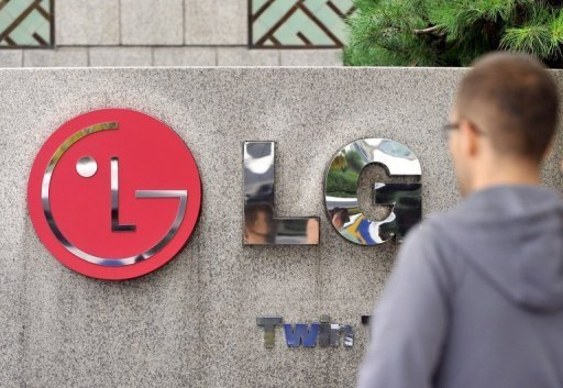 A man walks past a logo of LG in front of the headquarters of LG Electronics in Seoul on October 24, 2012. South Korea's LG Electronics hope sales of its new television using a next-generation display will boost growth against giant rival Samsung