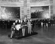 The casket of former U.S. President John F. Kennedy is placed in the Capitol Rotunda in Washington, in this handout image taken on November 24, 1963. REUTERS/The John F. Kennedy Presidential Library/Handout