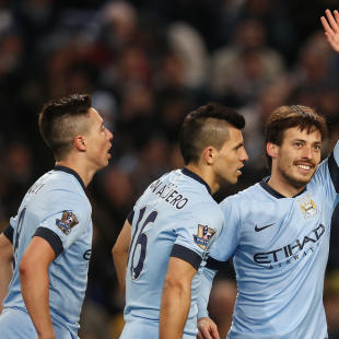 Football: David Silva celebrates with team mates after scoring the fourth goal for Manchester City