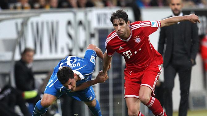 Hoffenheim's Kevin Volland, left, and Bayern's Javier Martinez of Spain challenge for the ball during a German first division Bundesliga soccer match between TSG 1899 Hoffenheim and Bayern Munich in Sinsheim, Germany, Saturday, Nov.2, 2013