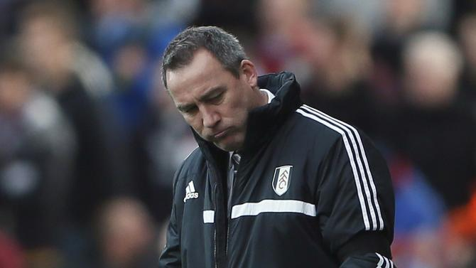 Fulham's manager Meulensteen reacts after their English Premier League soccer match against Aston Villa at Craven Cottage in London