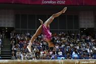 US gymnast Gabrielle Douglas performs on the beam during the artistic gymnastics women's individual all-around final during the London 2012 Olympic Games. Douglas won gold