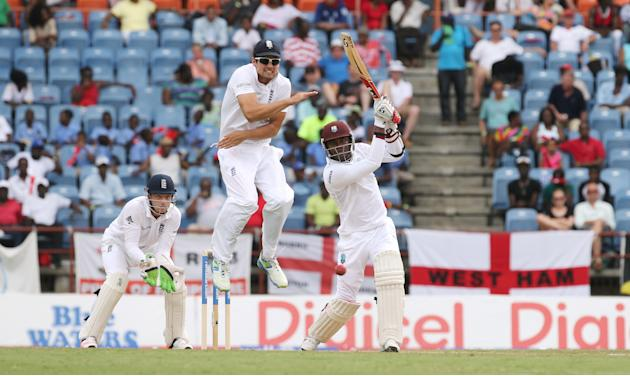 Cricket: West Indies Marlon Samuels in action with England's Alastair Cook