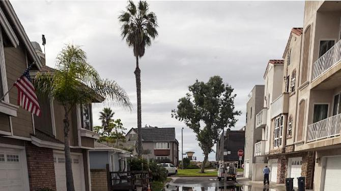 An overflowed street adjacent to Pacific Coast Highway  is seen in the Sunset Beach area of Huntington Beach, Calif., Thursday, Dec. 13, 2012. Astronomical high tides have caused minor street flooding in some low-lying areas along the Southern California coast. (AP Photo/Damian Dovarganes)