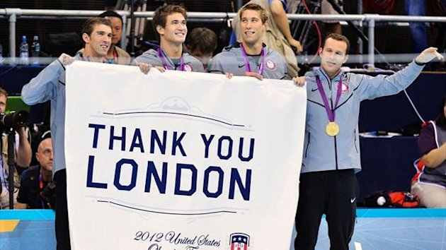 Michael Phelps, Nathan Adrian, Matthew Grevers and Brendan Hansen of the U.S. hold a banner thanking host city London, after receiving their gold medals for the men's 4x100m medley relay final (Reuters)