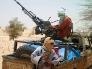 Islamist rebels of Ansar Dine are pictured on April 24, 2012 near Timbuktu, rebel-held northern Mali. The March 22 coup in Mali allowed Tuareg rebels and Islamists to make large gains in the country's desert north