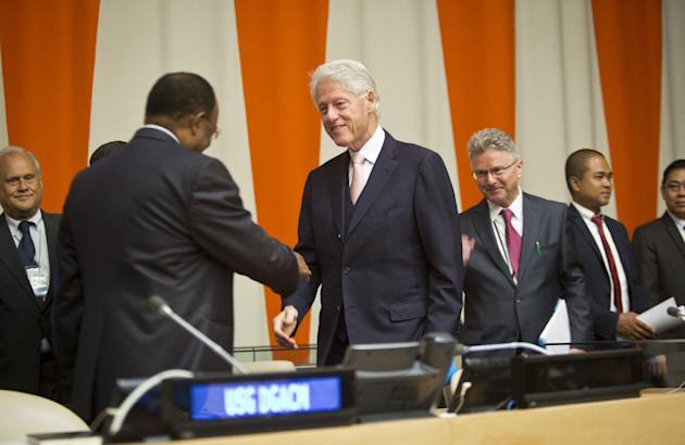 Former U.S. President Bill Clinton, center, arrives at the United Nations for a meeting of the Economic and Social Council (ECOSOC), to address the  54-nation council on philanthrophy and global publi