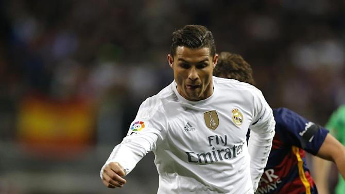FILE  - In this Nov. 21, 2015 file picture Real Madrid's Cristiano Ronaldo challenges s for the ball with Barcelona´s Sergi Roberto during  the match between Real Madrid and FC  Barcelona at the Santiago Bernabeu stadium in Madrid, Spain. Neymar has made the three-man Ballon D'Or 2015  shortlist for the first time, alongside Barcelona teammate Lionel Messi and title holder Cristiano Ronaldo.The winner is announced at a gala in Zurich on Jan. 11 , 2016.    (AP Photo/Francisco Seco,file)