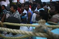 Photo illustration shows asylum-seekers from Sri Lanka sitting in their boat off Mentawai island, West Sumatra province. A group of Sri Lankans have chosen to return to their homeland rather than apply for asylum in Australia, where they faced being sent to a Pacific island for processing, the government said Saturday