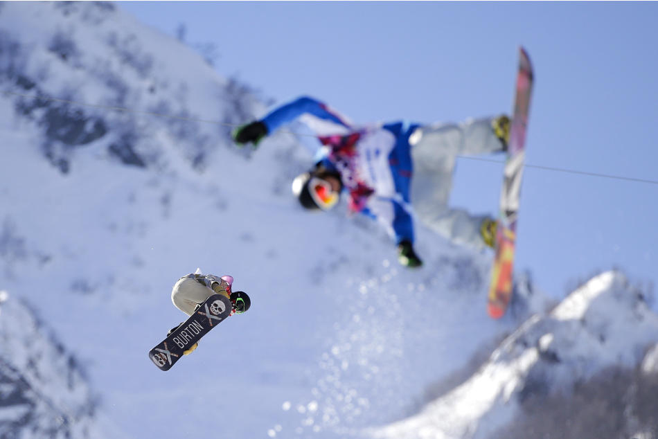 Shaun White, left, of the United States catches air during a training session for the men's snowboard halfpipe at the 2014 Winter Olympics, Saturday, Feb. 8, 2014, in Krasnaya Polyana, Russia. (AP