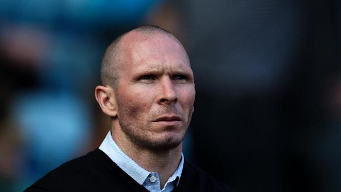 Michael Appleton has played down talk over the Bolton job