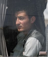 A Syrian refugee looks from a bus as they arrive in a camp set up by Turkish Red Crescent in the Turkish town of Altinozu in Hatay province, Turkey, Friday, June 10, 2011. The region borders Turkey, which said Wednesday it would open the border to Syrians fleeing violence.(AP Photo/Burhan Ozbilici)