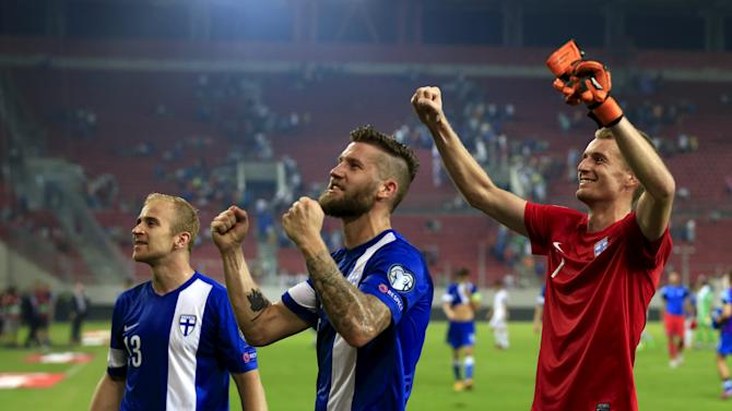 Finland's players celebrate their team's victory against Greeece for their Euro 2016 group F qualification match at the Karaiskaki stadium in Piraeus, near Athens