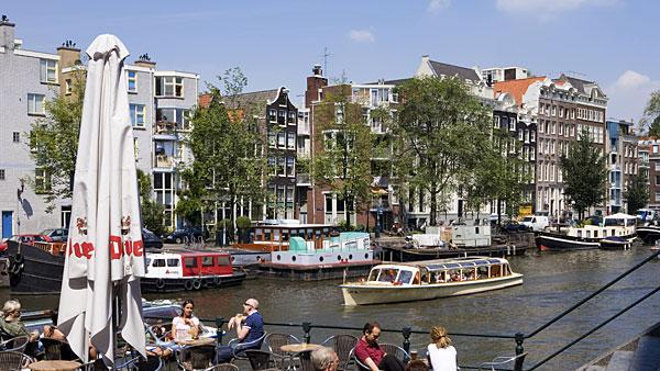 4. Netherlands Highest income tax rate: 52%  Average 2010 income: $57,000   Holland's highest tax rate of 52 percent is much higher than the regional average of 45.7 percent in Western Europe.   The country's top marginal tax rate kicks in at about $74,500 of taxable income. Annual property taxes generally range between $470 and $800. Other notable taxes include a capital gains tax of 25 percent, a land transfer tax of 6 percent and an inheritance tax that varies between 10 percent and 40 percent.   The Netherlands, which has been in recession since July, announced a budget deal in April for 2013 that will freeze the incomes of civil servants for two years to save the government $3 billion by the end of 2013. Tax deductions for employee travel between work and home will also be reduced to save $1.58 billion, along with the raising of retirement age from 65 to 67 to grapple with the country's ballooning pension bill. Dutch government figures estimate that the overall effect of the tax increases and pay freeze will reduce consumer spending by 3 percent in 2013.   Pictured: Amsterdam  Photo: fotosol fotosol | Getty Images