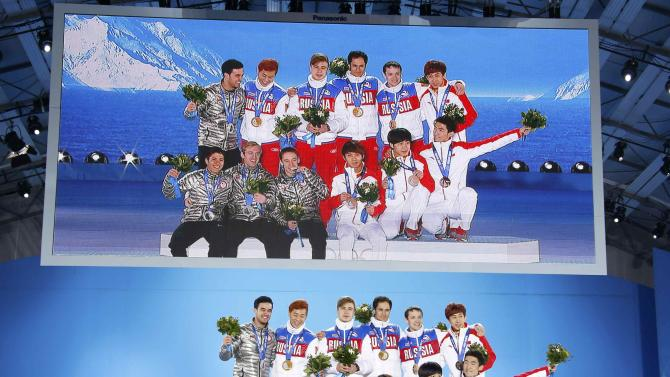 Gold medallists of Russia, silver medallists of U.S. and bronze medallists of China celebrate during the victory ceremony for the men's 5,000 metres relay short track speed skating event at the 2014 Sochi Winter Olympics in Sochi