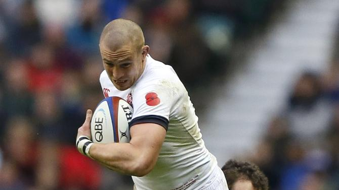 England's Brown is tackled by Argentina's Fernandez during their international rugby union match at Twickenham in London