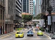 View of a street in Singapore's financial district in 2009. A wealthy Chinese expatriate who crashed his million-dollar Ferrari into a taxi killing himself and two others has sparked outrage in Singapore, where anti-immigrant sentiment is on the rise
