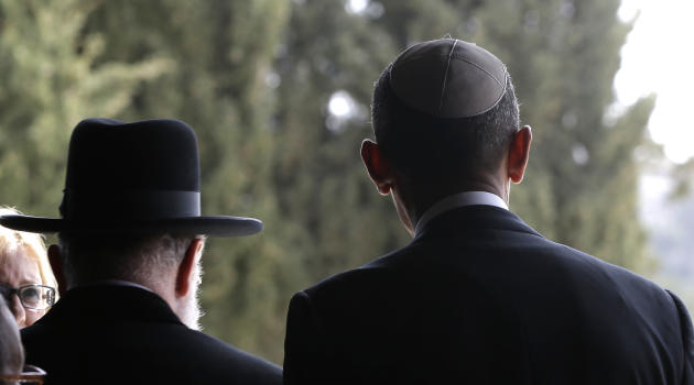 U.S. President Barack Obama, right, walks out with Rabbi Meir Lau, left, after visiting the Hall of Remembrance at the Vad Vashem Holocaust Memorial in Jerusalem, Israel, Friday, March 22, 2013. (AP P