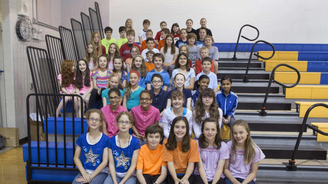 This June 6, 2013 photo shows twenty-four sets of twins who are fifth-graders at Highcrest Middle School in Wilmette, Ill. The school is attempting to break a Guinness World record for the amount of twins in one grade which is currently sixteen sets. (AP Photo/Scott Eisen)