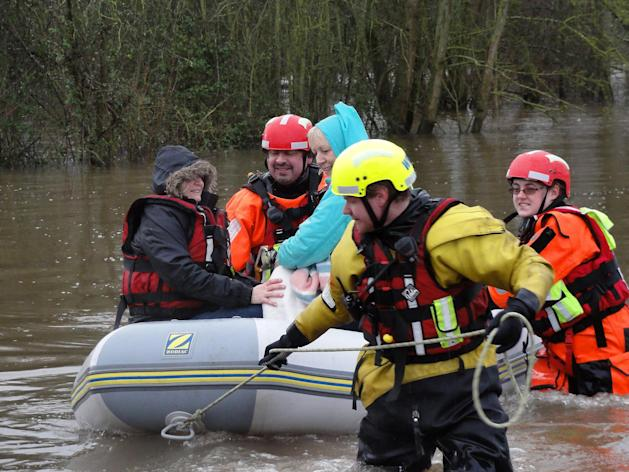 The holidaymakers were only evacuated when Search and Rescue crews braved the deep waters in two boats and ferried them to safety. Picture: Judy Gibson/SWNS