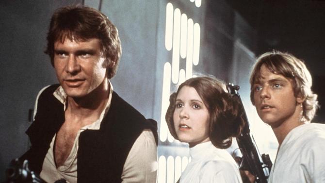 "FILE - This 1977 file image provided by 20th Century-Fox Film Corporation ahows, from left, Harrison Ford, Carrie Fisher, and Mark Hamill in a scene from ""Star Wars."" Fisher says she's coming back as Princess Leia for the new ""Star Wars"" films. The actress confirmed that she'll return as the iconic character in an interview posted Wednesday, March 6, 2013, with Florida's Palm Beach Illustrated. Casting for the films has yet to be announced, but Fisher answered a simple ""yes"" when asked if she would be reprising Leia.  (AP Photo/20th Century-Fox Film Corporation, file)"