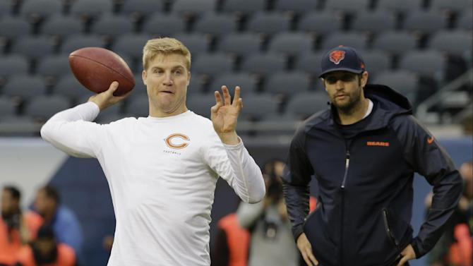 Chicago Bears quarterback Josh McCown, left, warms up as Jay Cutler watches before an NFL football game against the Baltimore Ravens, Sunday, Nov. 17, 2013, in Chicago