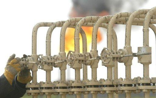 A flare burns at the North Rumaila oil field on January 19, 2010. Iraq's oil exports in December fell due to bad weather and a dispute with the Kurdish region, but the country still saw sharply higher income last year compared to 2011, according to new figures from Iraq's oil ministry
