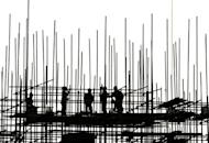 "Workers are silhouetted at a construction site in Beijing. Chinese Premier Wen Jiabao has said stabilising the country's economic growth was a ""top priority"", and authorities would encourage more investment"