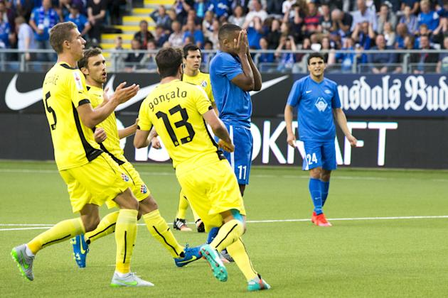 Molde's Ola Kamara reacts after he missed a penalty during the UEFA Champions League third qualifying round, second leg soccer match between Molde and Dinamo Zagreb at Aker Stadium in Molde, Norwa