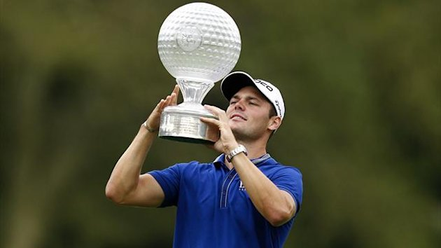 Martin Kaymer of Germany holds up the trophy after winning the 2012 Nedbank Golf Challenge in Sun City