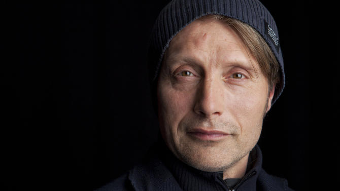 """This March 21, 2013 photo shows Danish actor Mads Mikkelsen poses for a portrait in New York.  Mikkelsen stars as Dr. Hannibal Lecter in the new series """"Hannibal,"""" premiering Thursday, April 4, at 10 p.m. on NBC. (Photo by Amy Sussman/Invision/AP)"""