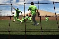 Undocumented immigrants play a game of soccer at the U.S. Immigration and Customs Enforcement (ICE) detention facility for illegal immigrants in 2010 in Florence, Arizona. US President Barack Obama suspended the threat of deportation against hundreds of thousands of young illegal immigrants Friday, delighting crucial Hispanic voters ahead of November's election