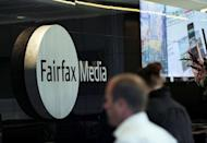 "A man walks past signage in the foyer of the Sydney office of Fairfax Media on June 18, 2012. One of Fairfax Media's largest shareholders warned Wednesday that the Australian firm's flagship titles faced closure without a major turnaround, describing them as ""worth less than nothing"""