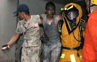 Thai firemen carry an injured man after a fire at the Lee Gardens Hotel in downtown Hat Yai. Five people were killed and dozens injured in a fire at a hotel in Hat Yai, the largest city in southern Thailand