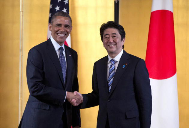 FILE - In this April 24, 2014 file photo, President Barack Obama shakes hands with Japanese Prime Minister Shinzo Abe as they arrive to participate in a bilateral meeting at the Akasaka State Guest Ho
