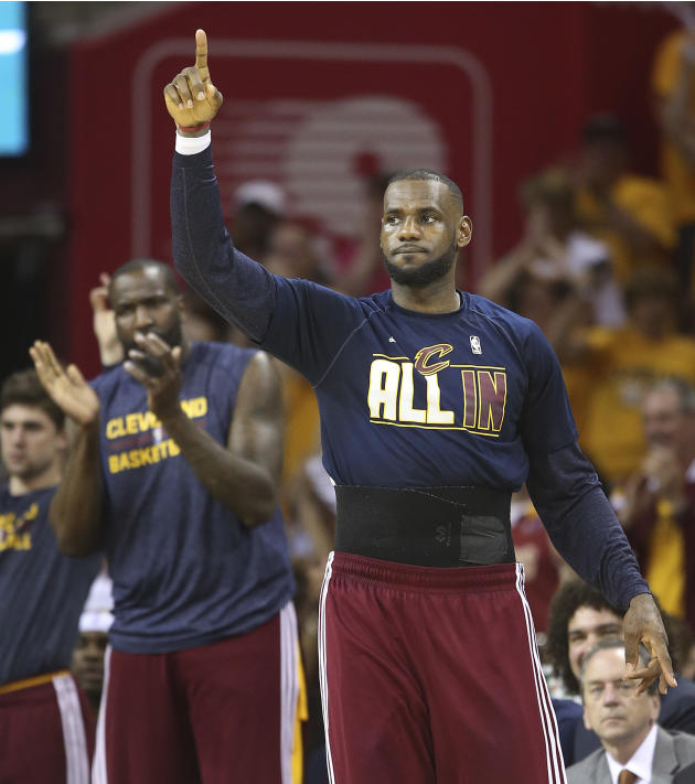 Cleveland Cavaliers forward LeBron James reacts on the sidelines late in the second half of Game 4 of the NBA basketball Eastern Conference Finals against the Atlanta Hawks, Tuesday, May 26, 2015, in