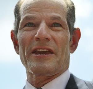 Eliot Spitzer tries to collect signatures for his run for New York City Comptroller in New York, Monday, July 8, 2013. Former Gov. Eliot Spitzer, who stepped down in 2008 amid a prostitution scandal, says he is planning a political comeback with a run for New York City comptroller.(AP Photo/Bethan McKernan)