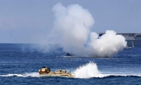 """U.S. military forces aboard Amphibious Assault Vehicles (AAV) manuevre on South China Sea near the shore of San Antonio, Zambales during the annual """"Balikatan"""" (shoulder-to-shoulder) war gam"""