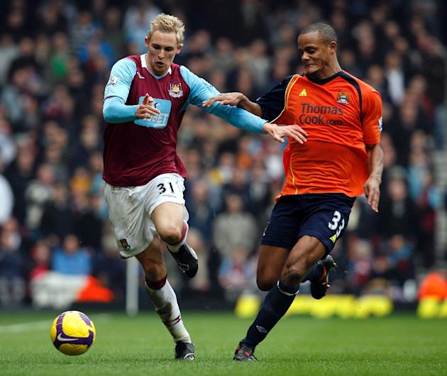West Ham United's Jack Collison (left) is challenged by Manchester City's Belgium player Vincent Kompany during their Premier League match at Upton Park in London on March 1, 2009