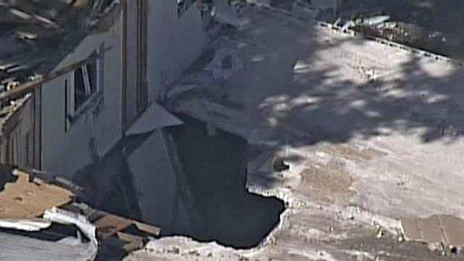In this video image provided by ABC Action News-WFTS TV, shows an aerial photo of a sinkhole Monday, Mar. 4, 2013, in Seffner, Fla. The hole opened up underneath a bedroom late Thursday evening and swallowed Jeffrey Bush in Seffner, Fla. (AP Photo/ABC Action News-WFTS TV)