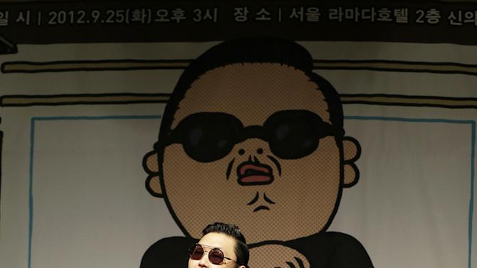 "In this Sept. 25, 2012 photo, South Korean rapper PSY, who sings the popular ""Gangnam Style"" song, performs during a press conference in Seoul, South Korea. As ""Gangnam Style"" gallops toward 1 billion views on YouTube, the first Asian pop artist to capture a massive global audience has gotten richer click by click. So too has his agent and his grandmother. But the money from music sales isn't flowing in from the rapper's homeland South Korea or elsewhere in Asia. With one song, 34-year-old Park Jae-sang — better known as PSY — is set to become a millionaire from YouTube ads and iTunes downloads, underlining a shift in how money is being made in the music business. (AP Photo/Lee Jin-man)"