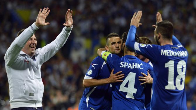 Bosnia's players celebrate after their 2014 World Cup qualifying soccer match against Slovakia in Zilina