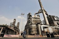 This file photo shows a Sinopec oil refinery in Wuhan, central China's Hubei province, pictured in 2011. Chinese oil giants Sinopec and Petrochina said they were hit by heavy refining losses in the first quarter, despite strong energy demand and higher oil prices