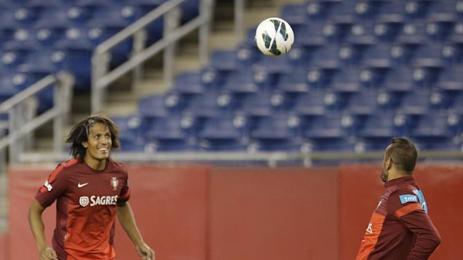 Midfielder Bruno Alves. left, and keeper Eduardo, of Portugal's national soccer team, loosen up during practice in Foxborough, Mass., Monday, Sept. 9, 2013. Portugal will play team Brazil in a friendly match Tuesday in Foxborough