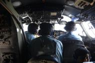 Vietnamese Air Force officers sit in the cockpit of a search and rescue aircraft as they fly over the search area for a missing Malaysia Airlines plane, 250 km from Vietnam and 190 km from Malaysia, March 9, 2014. REUTERS/Stringer