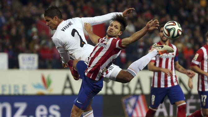 Real Madrid's Varane and Atletico Madrid's Ribas fight for the ball during their Spanish King's Cup semi-final second leg soccer match in Madrid