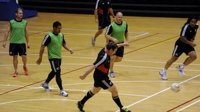 New Zealand All Blacks Andrew Hore kicks the ball during a game of indoor soccer at a training session in Auckland, New Zealand, Tuesday Oct 18, 2011. New Zealand play France in the Rugby World Cup final in Auckland, New Zealand Sunday Oct 23.    (AP Photo/Ross Land)