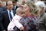 French President Francois Hollande (left) speaks with with a woman holding her baby in Dieudonne, north of Paris, this week. Fresh from his victory last month over right-winger Nicolas Sarkozy, Hollande is set to consolidate his hold on power as he seeks to navigate France through Europe's financial crisis, rising joblessness and a stagnant economy
